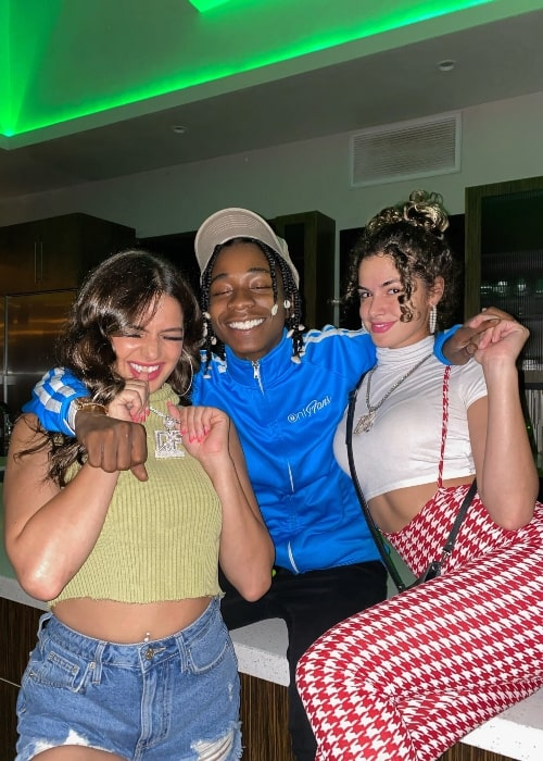 Zay Hilfiger as seen in a picture with two women in August 2021