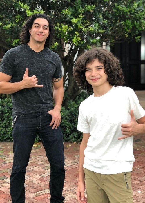 Alex J. Montero (Right) as seen while posing for a picture with Anthony Giovanni Elias in June 2020