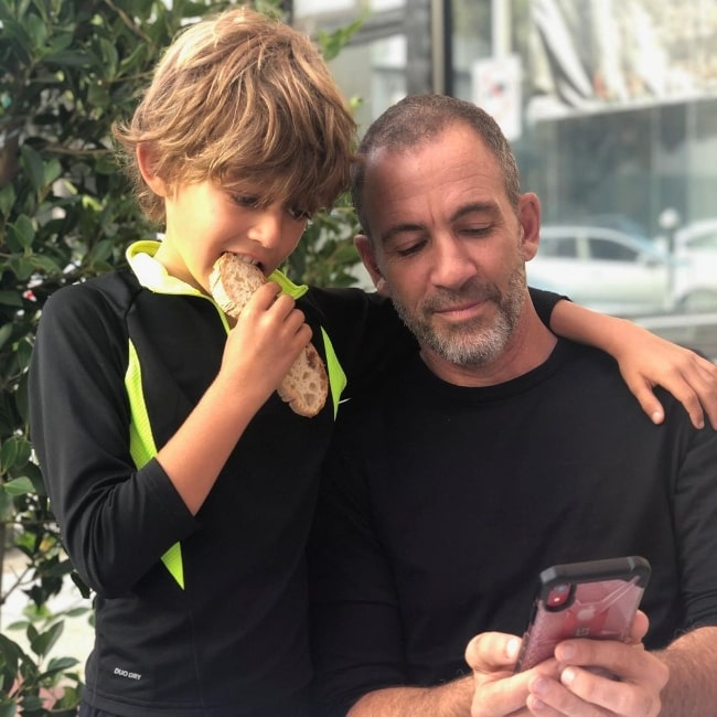 Bryan Callen in a picture with his son