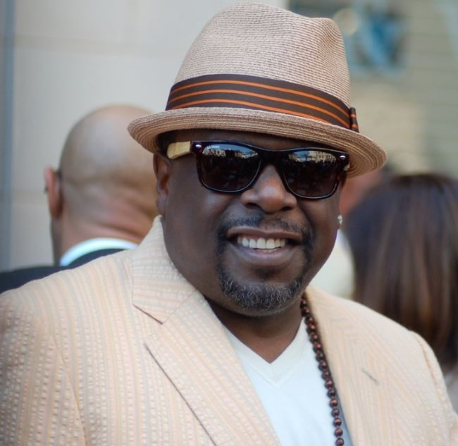 Cedric the Entertainer pictured at a ceremony for Steve Harvey receive a star on the Hollywood Walk of Fame in May 2013