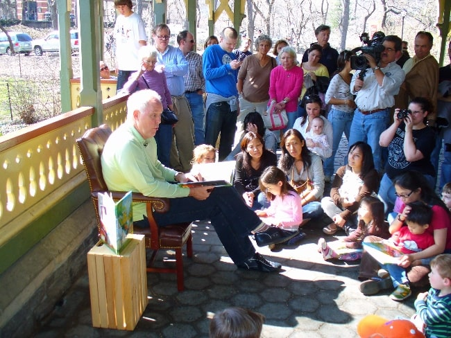 John Lithgow pictured while reading a book to children in 2007