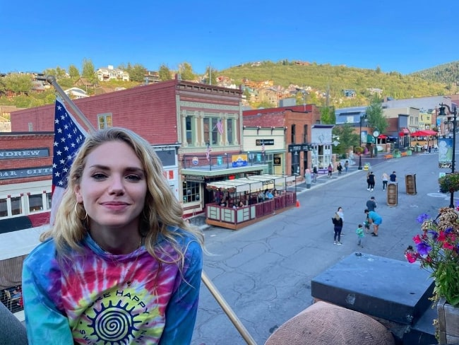 MacKenzie Mauzy as seen while smiling for a picture in Park City, Utah in August 2021