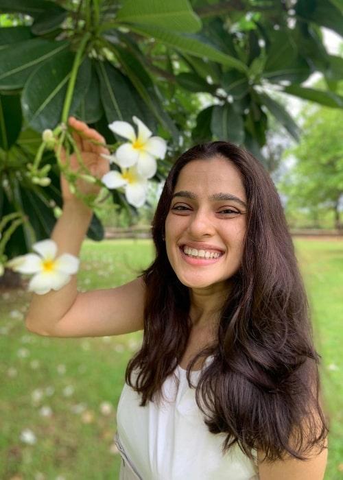 Priya Bapat smiling for a picture in June 2021