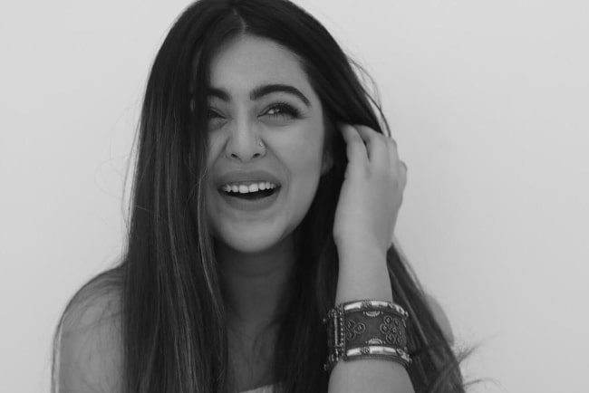 Shafaq Naaz as seen while smiling in a black-and-white picture in 2019
