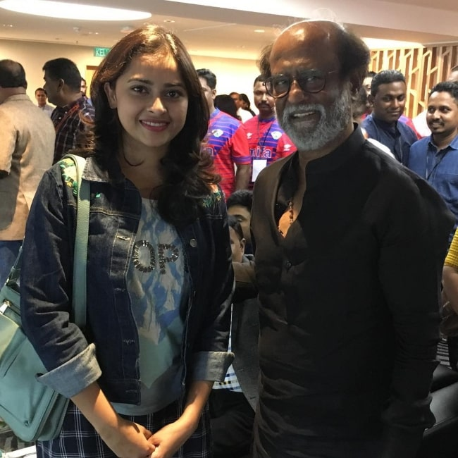Sri Divya as seen in a picture that was taken with legendary actor Rajinikanth in December 2018