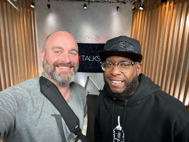 Tom Segura (Left) as seen while taking a selfie with Talib Kweli in July 2021