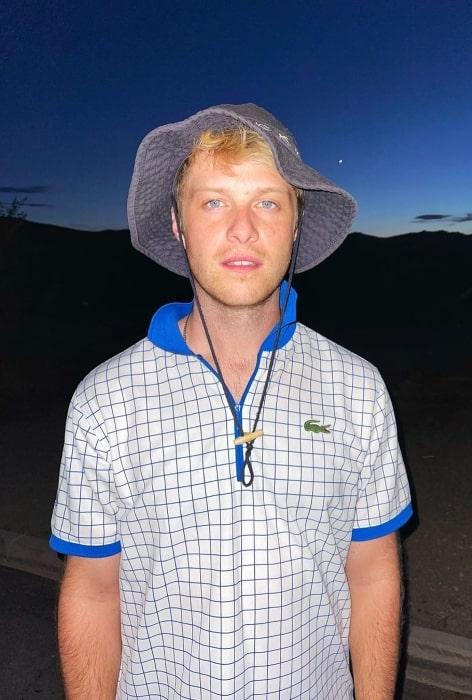 Tyler Barnhardt posing for the camera at Joshua Tree National Park in California in July 2021