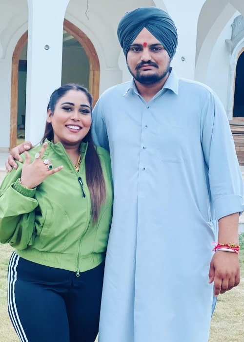 Afsana Khan posing for a picture alongside Sidhu Moose Wala in Chandigarh, India